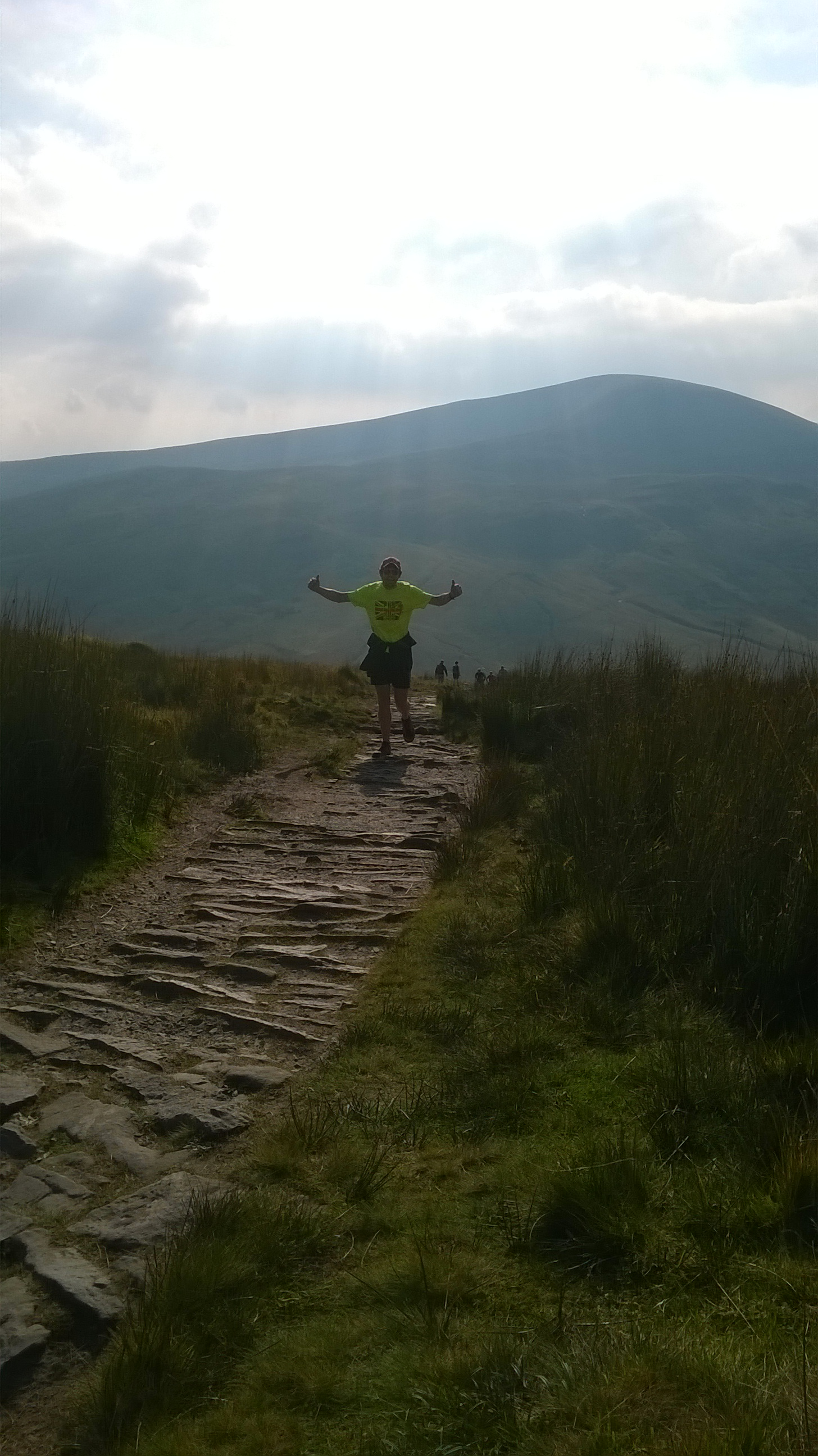 Jools on 'cool down' run up Corn Du, with Fan Fawr in background